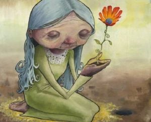 Staruszka z kwiatem w rękach