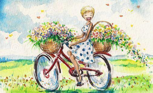 Uśmiechnięta dziewczyna na rowerze