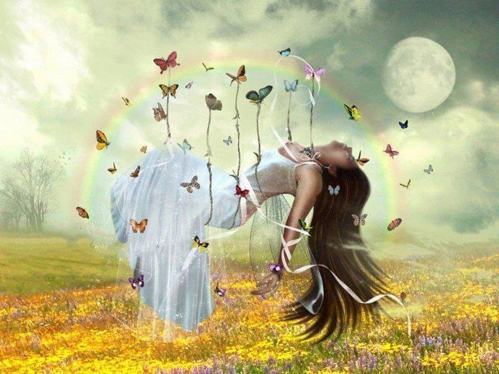 Kobieta unoszona przez motyle