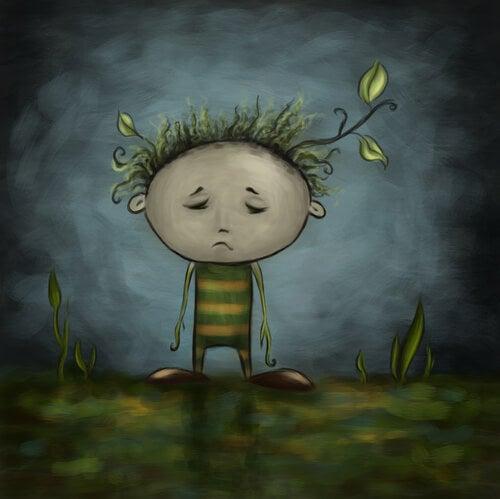 Smutny chłopiec z liściem na głowie
