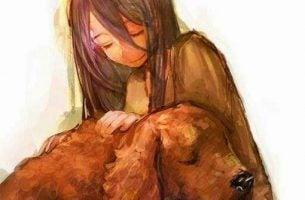 Dziewczynka trzyma zwierzę - psa