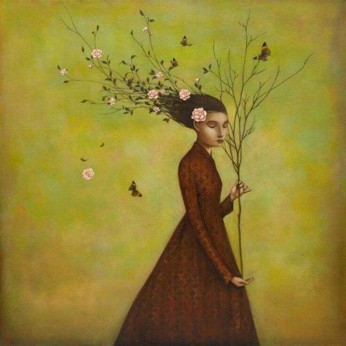 Kobieta trzymająca gałąź