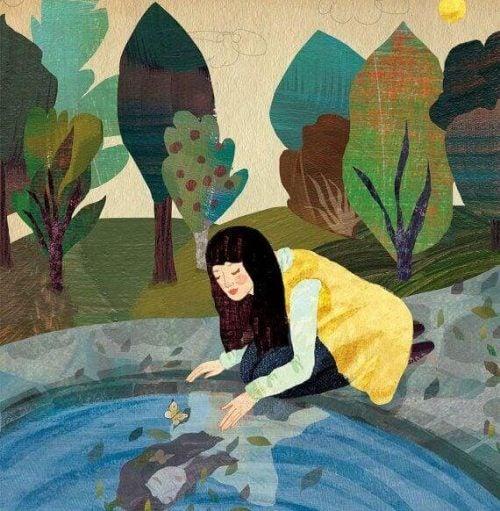 Dziewczyna nad stawem przeglądająca się w wodzie