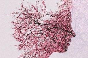 Choroba Alzheimera przedstawiona jako porośnięta kwiatami twarz