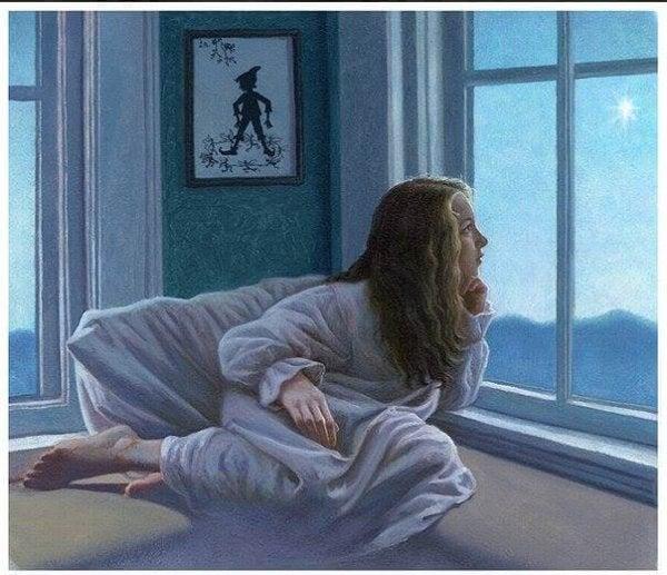 Dziewczynka, która wygląda w nocy przez okno