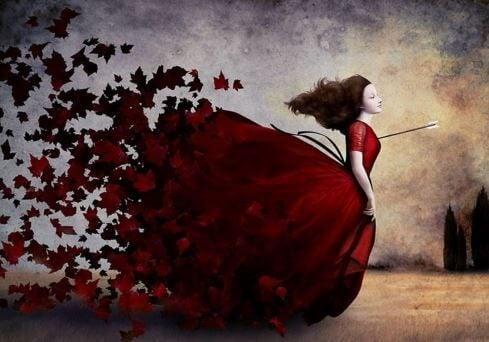 Kobieta w czerwonej sukni zraniona strzałą