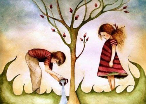 Dzieci podlewające drzewo