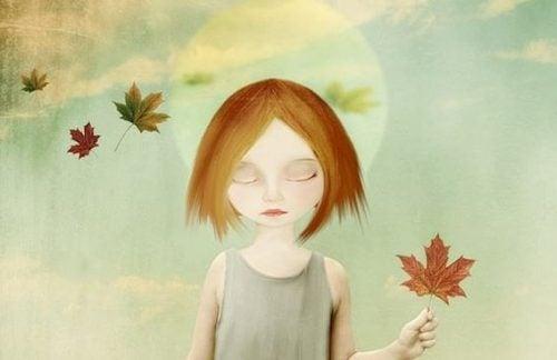 Dziewczyna pośród liści przedstawiających emocje