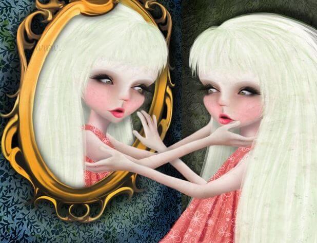 Dziewczynka dotyka w lustrze swojego odbicia.