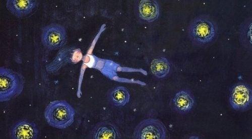 Dziewczynka pływająca po gwiaździstym niebie