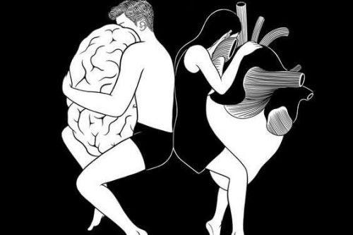 Męzczyzna obejmujący mózg i kobieta obejmująca serce