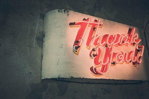 Neon z napisem dziękuję