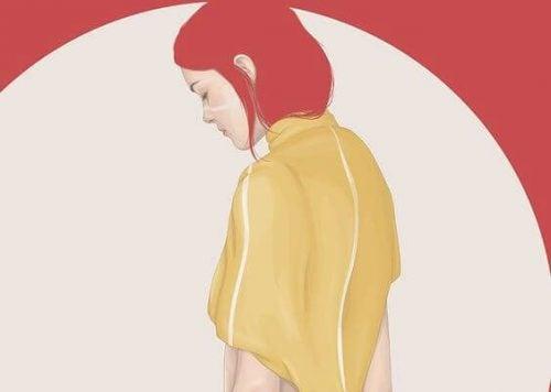 Smutna kobieta o czerwonych włosach