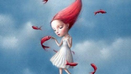 Dziewczyna z czerwonymi włosami i rybami