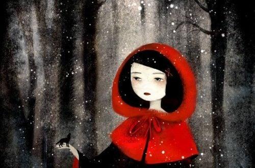 Hipokryzja - dziewczyna w czerwonym kapturze trzymająca na dłoni wilka