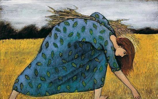 Kobieta zbiera pszenicę z pola.