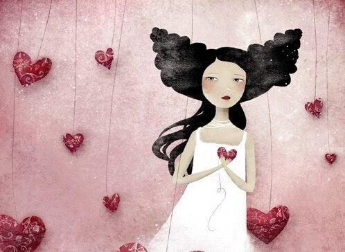 Kobieta i serca na patykach