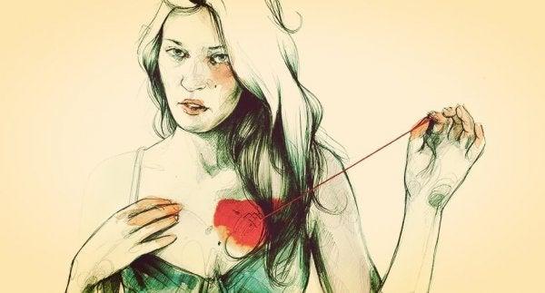 Kobieta wyciąga sobie serce.