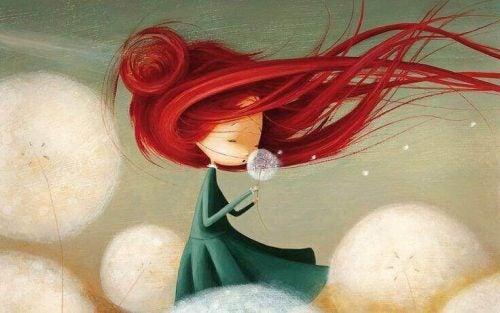 Dziewczyna o czerwonych włosach z mniszkiem