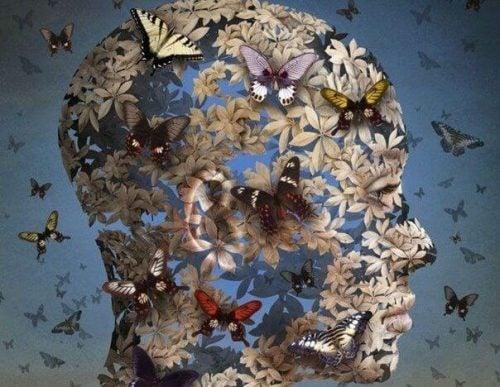 Głowa utkana z motyli i kwiatów