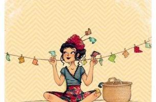 Kobieta wiesza kolorowe skarpetki na sznurku