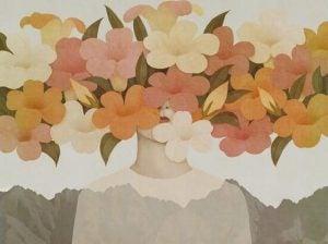 Kolorowe kwiaty i dziewczyna ukryta za nimi.