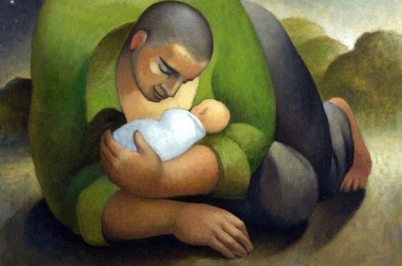 Ojciec trzyma w ramionach dziecko.