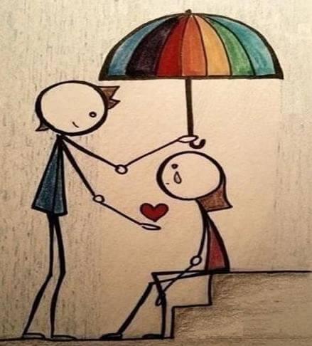 Chłopak trzyma parasol nad dziewczyną