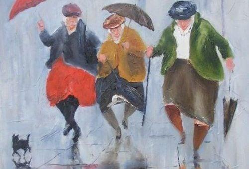 Starość- starsze panie z parasolami.