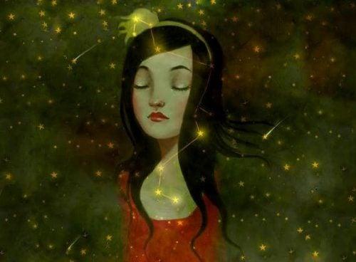 Dziewczyna myśli wśród gwiazd