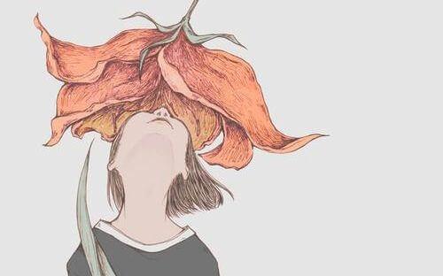 Wyobraź sobie zapach - dziewczyna wącha kwiat.