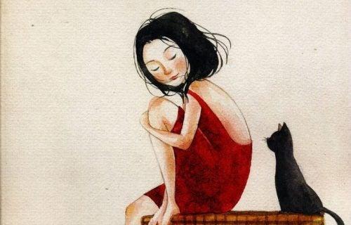 Dziewczyna w czerwonej sukience i czarny kot