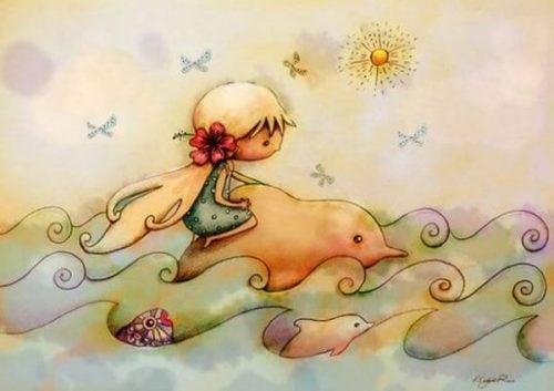 Dziewczynka płynie na delfinie