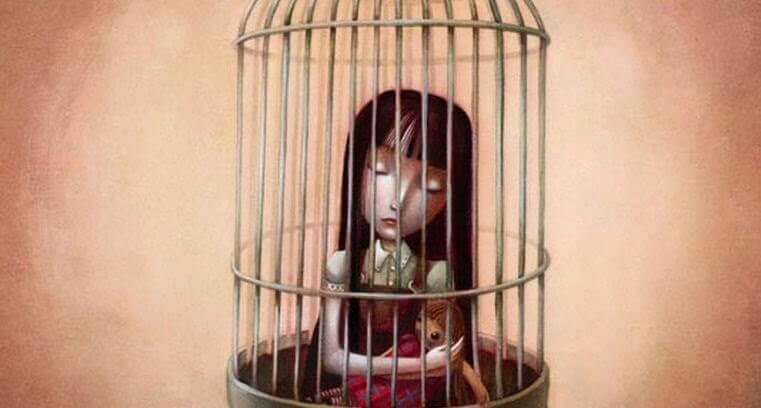 Przemoc emocjonalna - dziewczynka w klatce.