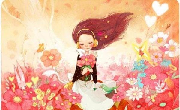 Dziewczynka z kwiatami w dłoni.