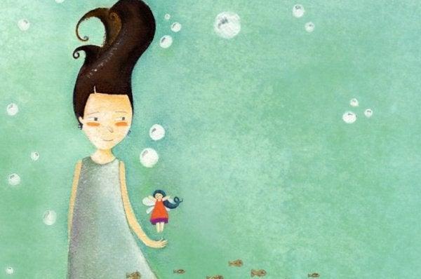 Dziewczyna i mała laleczka.