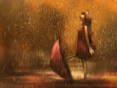 Dziewczynka z parasolem w deszczu.