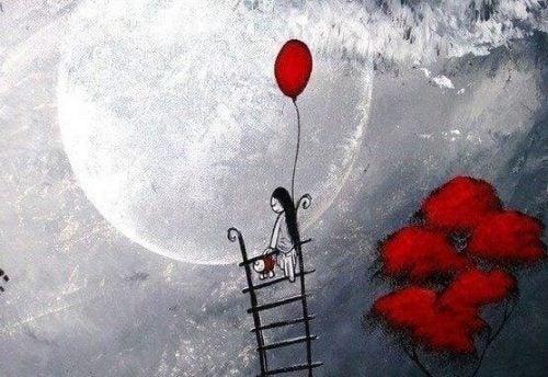 Kobieta na drabinie i czerwony balon