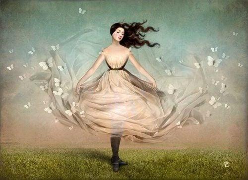 Kobieta w sukni wśród motyli