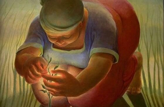 Kobieta opiekująca się roślinką.