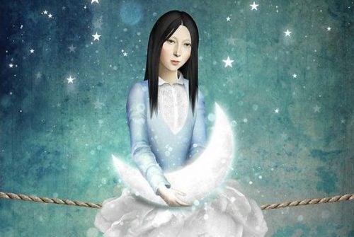Kobieta trzyma księżyc