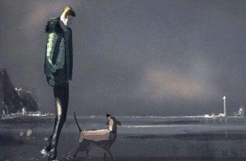 Samotny człowiek z psem na brzegu morza