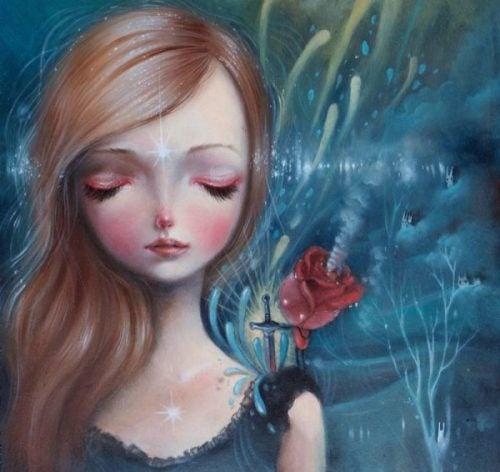Wrażliwi ludzie - smutna dziewczyna i czerwona róża