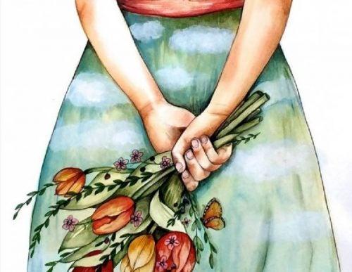 Dziewczyna trzyma bukiet kwiatów - wrażliwi ludzie dają prezenty