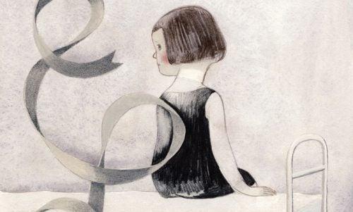 Dziewczynka siedzi na łóżku