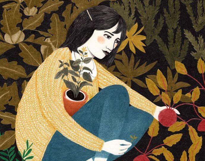 Kobieta sadząca w ogrodzie rośliny.