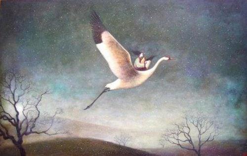 Kobieta z dzieckiem lecą na ptaku