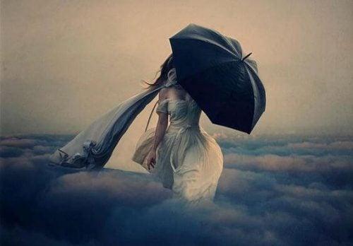 Nieszczęście - kobieta w chmurach z parasolem