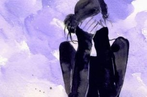 Emocje - kobieta, która zakrywa twarz rękoma.