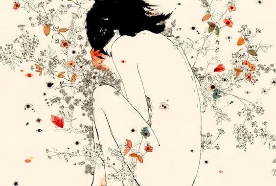 Naga kobieta w kwiatach.